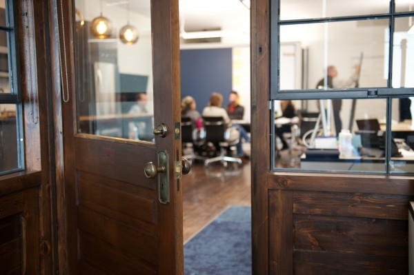Locally-reclaimed wood helps open the door to a more personable workplace